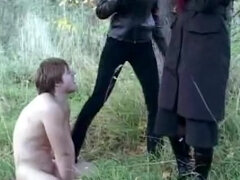 Submissive sex slave treated like a dog outdoors