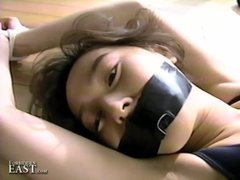 Pretty Oriental women bound and restrained for intense fetish fun