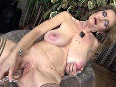 Posh grandma with large saggy breasts