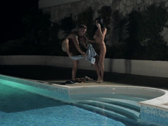 A bigtitted slut is in the pool with her man during the night