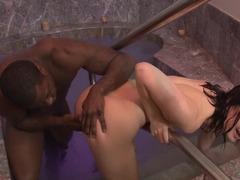 A hot white porn model gets a huge black ramrod inside her pussy