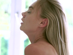 A blonde with long hair is sucking cock and her natural tits are bouncing