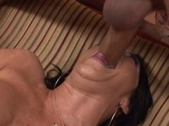 A raven haired soccer mom is in her high heels as she is sucking a knob