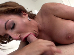 A brunette with sizeable tits gets a dick in her mouth today