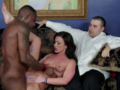 A hot brunette is getting fucked in front of her husband by a black guy