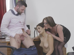 Sexy chicks are fooling around on the desk with a guy in a three-way