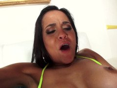 A brunette with sizeable bra buddies is getting her wet booty plugged up