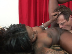 A large tooshie black chick is getting a white cock inside her cunt