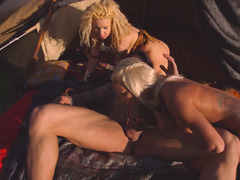 A strong lad undresses and fucks two hot females in a tent