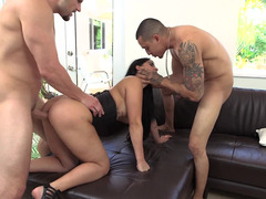 A couple of dudes are licking and banging a broad in her corset