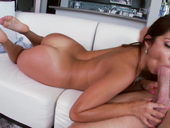A hot brunette with sexy feet is getting her honey pot penetrated
