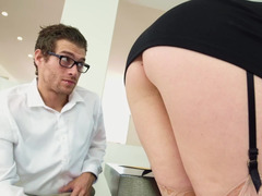 A brunette with sizeable tits is riding a hard cock like a skillful in the office