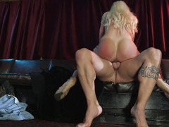 Blonde with huge jugs is getting her lips around a sizeable cock