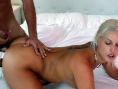 A blonde that has her thong on is getting her snatch licked
