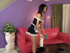 A small woman removes her maid outfit and then she works on a sizeable fuck tool