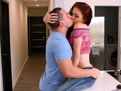 A redhead with little nipples is getting kissed and fucked too