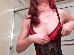 Redhead is stripping and is then riding a hard flag pole