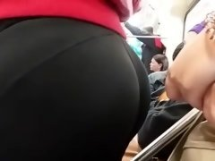 Tight 18-19 y.o. ass in spandex leggings on the train