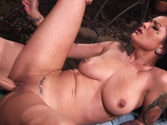 A breasty minx is taking off her clothes to get rammed outdoors