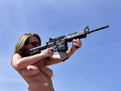 Undressed xxx stars shooting guns and having an intercourse in the desert