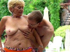A plump granny gets naked by the pool and she gets fucked there