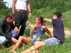European kitten enjoys a gangbang in the grass with three aroused guys