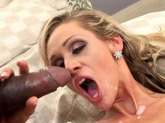 A blonde is getting cum eruption in her mouth by a black dude