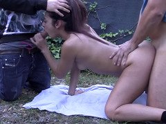 Money made dirty prostitute Lucia Nieto give blowjob a pair of peckers outdoors