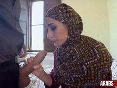Clothed Arab Dame gets on Her Knees for U.s. Cock
