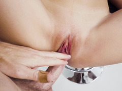 A chick with small dark nipples is doing a blow job like a pro