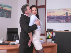 A broad is with her boss in the office and she is spreading her legs for him