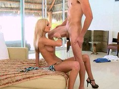 Blonde stripper is dancing around a pole and additionally is having sex also