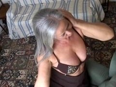 Beautiful big-breasted granny in stockings unclothing