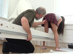 Schoolgirl seduces a horny grandpa and gets her titties licked