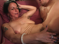 A granny with saggy bra buddies is getting penetrated deeply in this clip