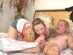 A blonde is getting an mature dick inside her love hole on the bed