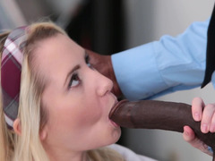 A smoking hot bimbo is getting a sizeable black pecker inside her cunt