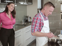 A duo girls are in the kitchen, pleasing a guy in a hot three-way
