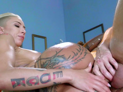 Tattoo covered blonde is getting her cum bucket penetrated by dick