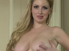 A blonde with bouncy natural tits is rubbing her wet cunt lips