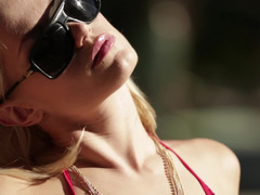 Pure beauty touches her mind-boggling body sunbathing by the pool