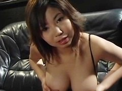 avmost.com  Lactating broad squeezes a purple rod between her huge breasts