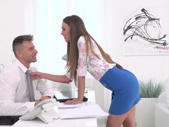 A sexy brunette gives her doctor a blow job in this office