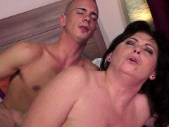 A hot granny is placing her mouth on a youthful and hard ramrod