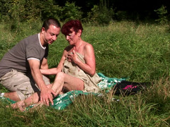 A granny gets naked in the forest and also fucked on the towel