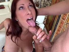 Hot sexually available mom with red hair is getting a hot load of cum in her mouth