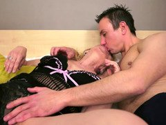 A blonde granny that loves penis is giving a blow job to her partner