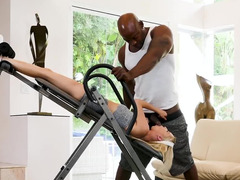 Slender blonde blacked by muscular therapeutist