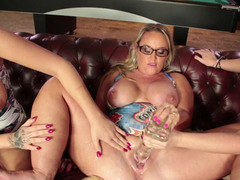 Three kinky chicks are playing pool and moreover they are using dildos