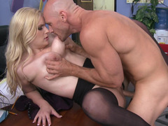 Hot blonde is getting her muff rammed on top of the desk